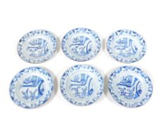 A set of six 18thC Chinese blue and white plates, decorated with oriental landscapes, 23cm