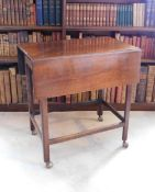 An early 19thC mahogany Pembroke table, with a plain planked top above a frieze drawer on
