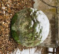A hand hewn stone petrosphere, 54cm diameter.
