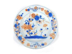 A 18thC Chinese plate, polychrome decorated with a floral landscape, 23cm diameter.