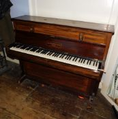 John Broadwood and Sons London. A upright piano in a rosewood case mounted with candle arms (lacking