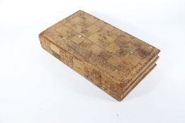 A 19thC back gammon box, with leather lined interior and gilt decorati