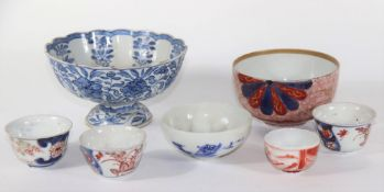 Six various 18th and 19thC Japanese porcelain bowls, and a Chinese blue and white stem cup wit