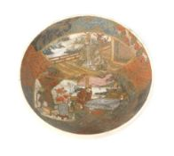 A Japanese Satsuma bowl, decorated with figures, vases in an interior scene, swirl mark to base,