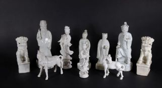 A group of 19thC and later Chinese Blanc De Chine figures, of temple dogs, horses and court figures,