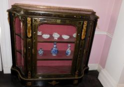 A Victorian Boulle and ebonised credenza, with a pierced gilt gallery, a concave frieze decorated
