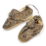 A pair of rare 18thC baby's pink silk shoes, overlaid with woven silver braid and embroidery,