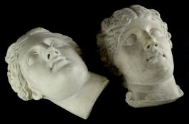 Two similar plaster wall masks, each cast in neoclassical style in the form of gentlemen, one