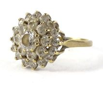 A cubic zirconia dress ring, with layered arrangement of stones, with central stone surrounded by