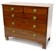 An early 19thC mahogany and boxwood strung chest of drawers, with plain top above two short and