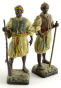 A pair of continental cold spelter figures , each modelled in the form of Arab or Moorish