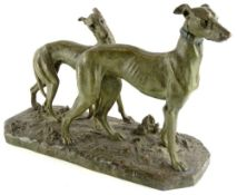 After J. Merculiano. Two greyhounds, bronze with verdigris finish, 40cm high, 60cm wide.