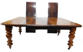 A Victorian mahogany extending dining table, the rectangular top with a moulded edge, on bulbous