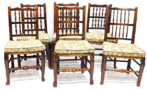 A Harlequin set of six 19thC Lancashire type spindle back dining chairs, each with a rush seat on