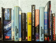 Science Fiction.- A shelf of mixed sci-fi, some signed by authors.