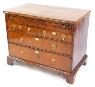 A William & Mary and later walnut bachelor's chest, of two short over two long drawers, with