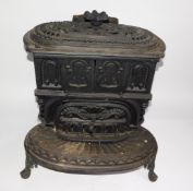 A Victorian cast iron kitchen range by The Columbian Stove Works., of oval form, with a pierced