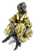 After Franz Xaver Bergmann (Austrian, 1861-1936). A cold painted bronze figure of a lady modelled in