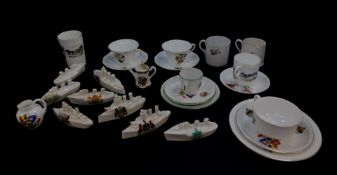 Eight crested china porcelain models of battle ships and other naval craft, crested and
