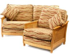 An Ercol elm and bergere two seater sofa, c2007, with wavy striped fabric cushions, 101.5cm wide,