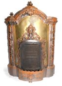 A French late 19thC cast iron and sheet metal fire by L Camus, of serpentine architectural form,