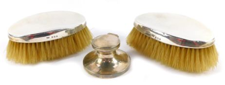 A pair of Edward VII silver backed hair brushes, Birmingham 1910, together with a George V silver