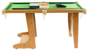 A BCE Le Club 5ft folding pool table, light oak framed with dart board to the reverse side, on a