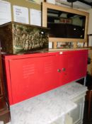 A red metal audio visual cabinet, 62cm high, 119cm wide, 36cm deep, with internal shelves and