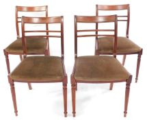 A set of four reproduction mahogany dining chairs.The upholstery in this lot does not comply with