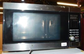 A TCM stainless steel microwave oven, model no 225045.