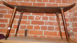 A mid 20thC bent wood coffee table, with cylindrical tapered legs with brass feet, 195cm high,