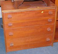 A Stag teak chest of four drawers, with oven knob style handles, 69cm high, 77cm wide, 43cm deep.