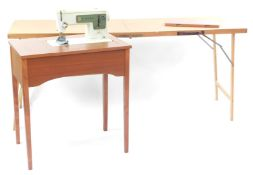 A Singer sewing machine, enclosed with a teak table, together with a pasting table, 77cm high,