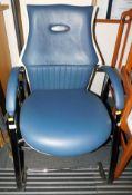 A blue and cream leatherette armchair with chrome frame.