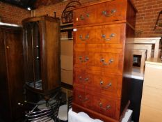 A walnut bow front china cabinet, together with a yew wood hi-fi cabinet, 121cm high, 66cm wide,