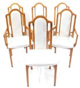 A set of six Caxton beech dining chairs, upholstered in cream floral damask, including two carvers.