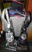 A Dyson ball DC25 animal upright vacuum cleaner, with accessories, together with a Dyson DC14