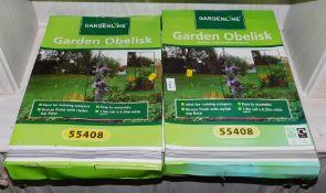 Two boxed Gardenline obelisks.