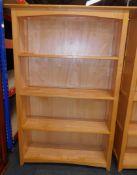 A beech bookcase, enclosing three shelves, 151cm high, 101cm wide, 34cm deep.