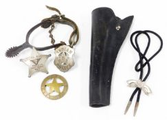 A group of American Wild West badges, uniform and gun holster, to include a black leather gun
