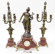 A late 19thC French clock garniture, with mantel clock, on a red marble base with a gilt spleter