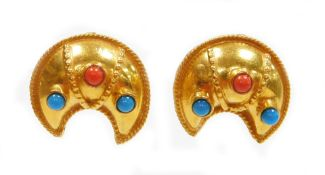 A pair of Indian design earrings, each of shaped design, set with turquoise and coral, with rope