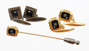 A group of cufflinks and other jewellery, comprising a pair of silver and jet set cufflinks, a