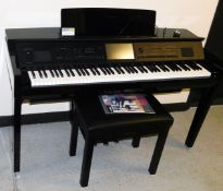 A Yamaha Clavinova CVP-809, in a black high gloss finish, with electronic touch screen panel, on a