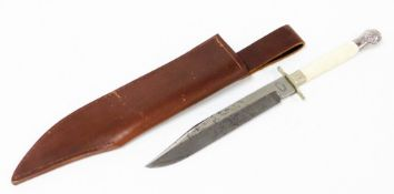 A Tiffany Broadway American knife, with a bone handle and silver plated scroll design ends, the
