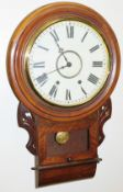 A late 19thC walnut cased drop dial wall clock, with a chime and a later white painted dial, 73cm