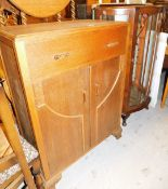 *A group of furniture, to include an Art Deco style oak side cabinet, with single drawer top on
