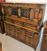 An Old Charm oak finish court cupboard, the carved oak top and baluster with display cabinet top,