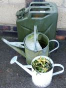 A military oil can and two watering cans. (3)