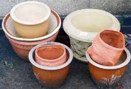 A group of various stone terracotta and other planters, wall mounted planters, etc. (8)
